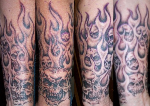 Grey Ink Skull Ripping Skin Tattoo On Shoulder