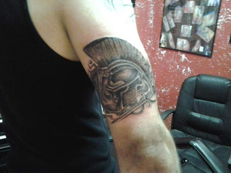 Grey Ink Spartan Helmet And Shield Tattoos On Arm
