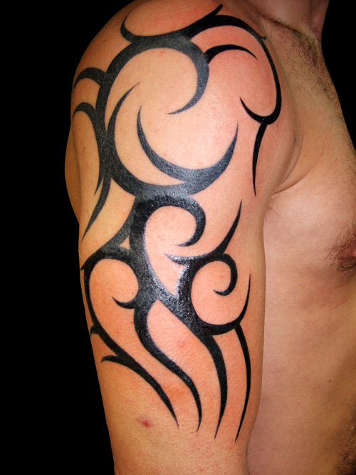 Grey Ink Tiger Tribal Tattoo For Biceps