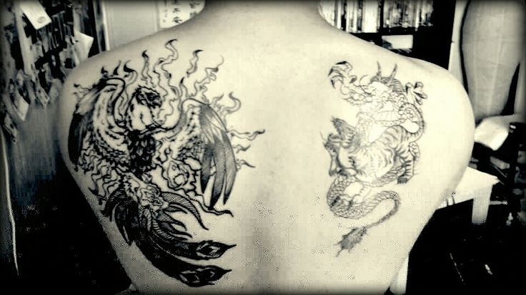 Grey Phoenix And Dragon Tattoos On The Back