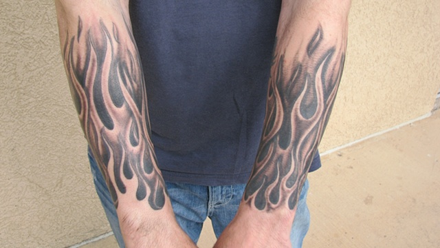 Grey Scorpion And Flame Tattoos On Wrist