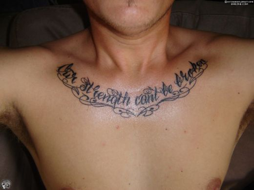 Guy With Collarbone And Chest Tattoos