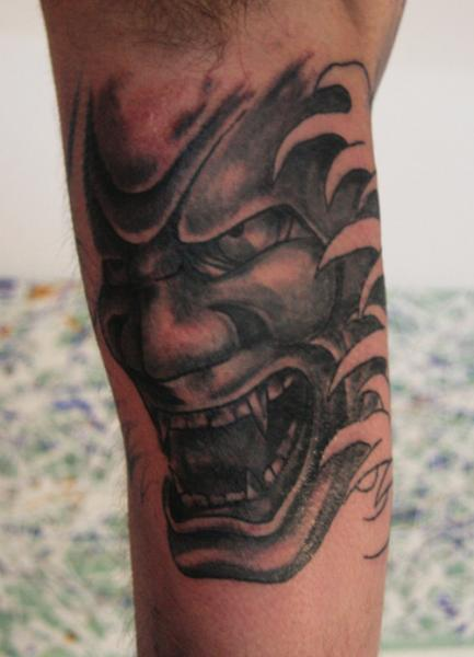 Hannya Mask And Flower Tattoo On Sleeve