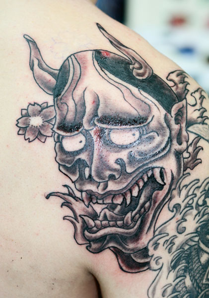 Hannya Mask With Blossoms Tattoos On Arm
