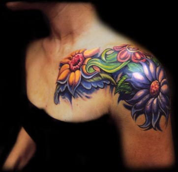 Hawaiian Flower Tattoo On Back Shoulder For Women