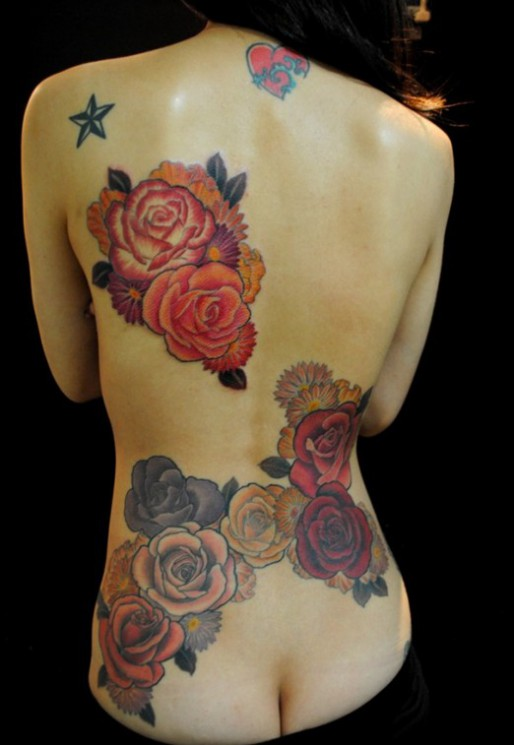 Heart Behind Blue Rose Tattoo On Upperback