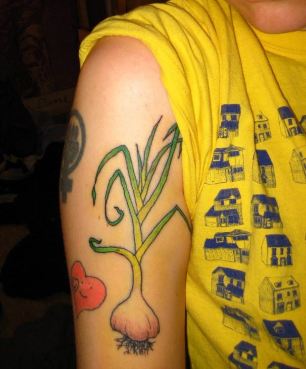 Heart n Garlic Tattoo On Right Upper Arm