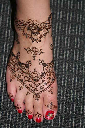 Henna Tattoo Design On Right Foot For Girls