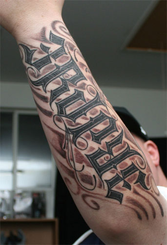 Henry Ambigram Tattoo With Crown On Back
