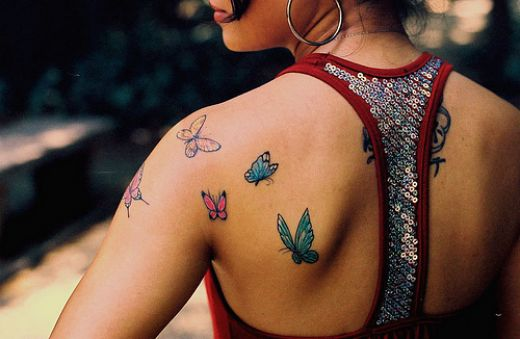 Hummingbird Carrying Flower Tattoo Design