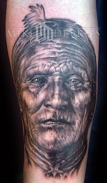 Indian Face Portrait Tattoo On Muscles