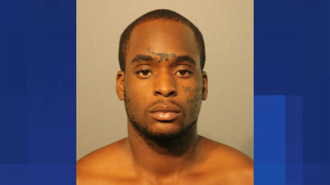 Inmate With Gun Tattoo on Forehead