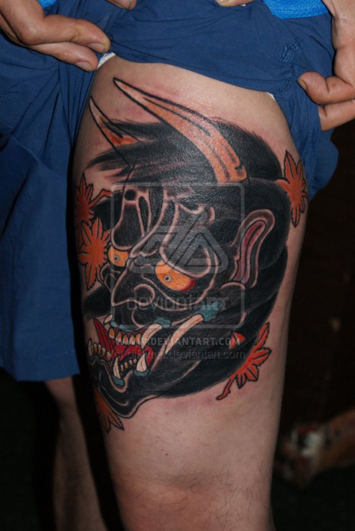 Japanese Mask Tattoo On Thigh