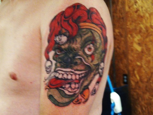 Joker Skull With Hat Tattoo On Arm