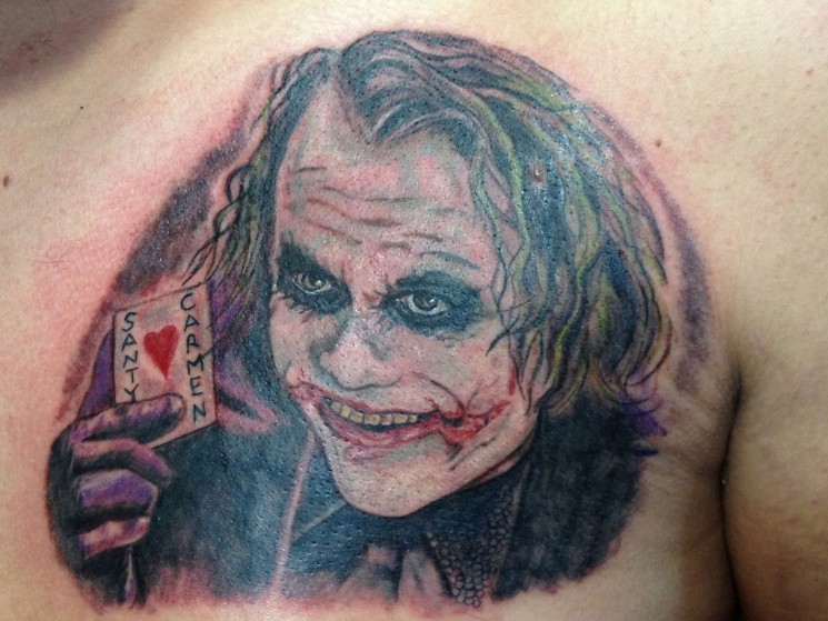 Joker With Card Tattoo On Chest
