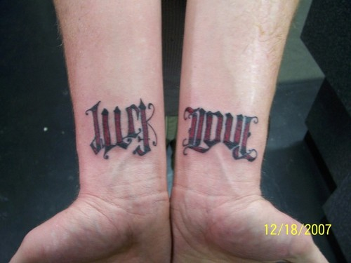 Just Love Ambigram Tattoo On Wrist