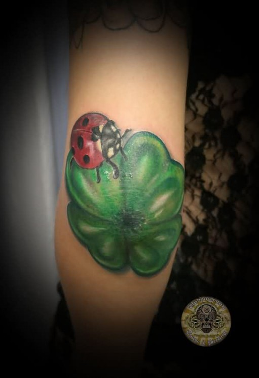 Lady Bug On Clover Tattoo On Elbow