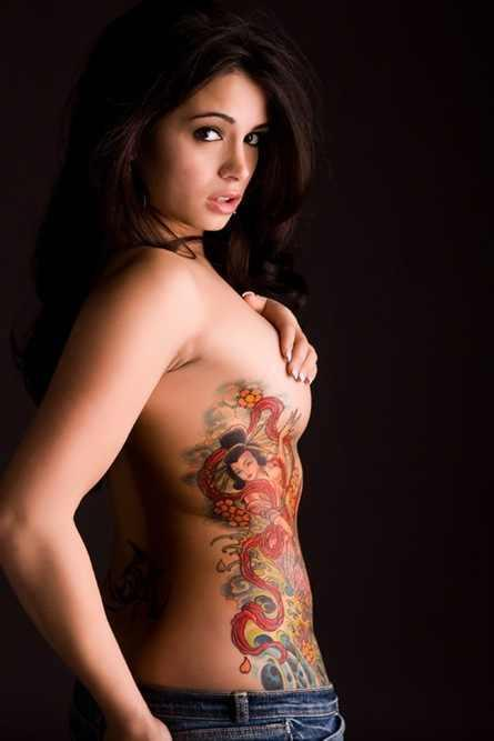 Large Old Style Pin Up And Tribal Tattoos On Back