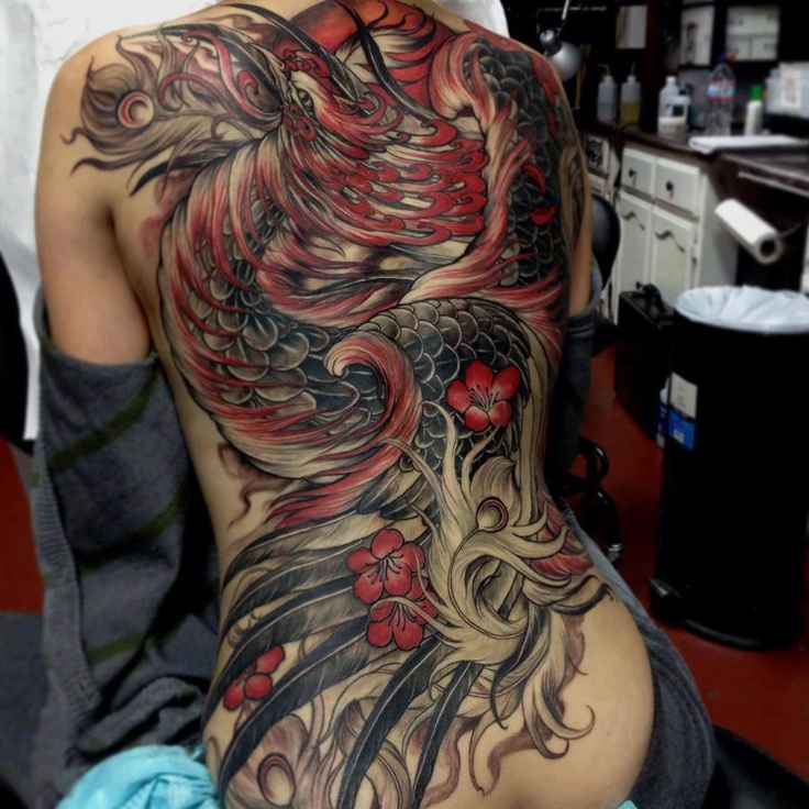 Large Phoenix And Red Flames Tattoos On Whole Back