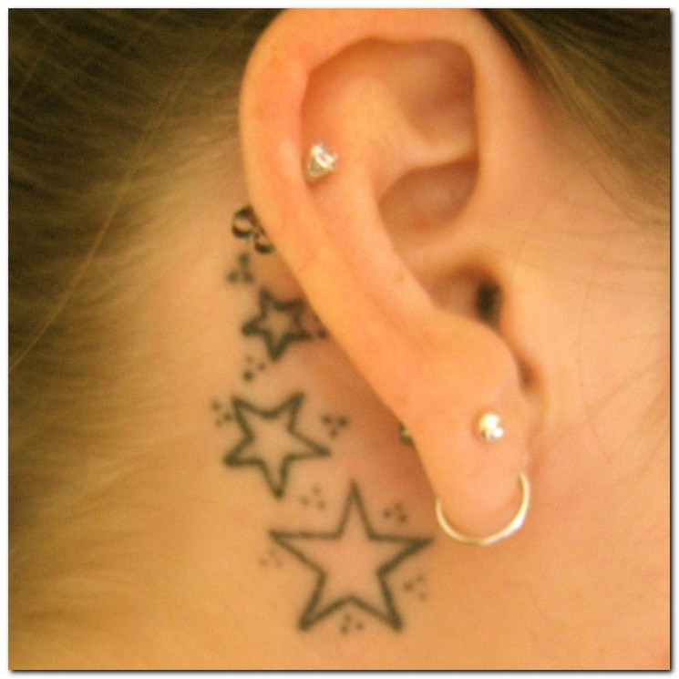 Large Pierced Ear And Star Tattoos For Guys