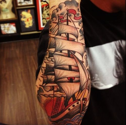 Latest Colored Ship Tattoo On Bicep