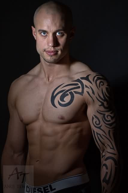 Latest Tribal Chest And Muscles Tattoo