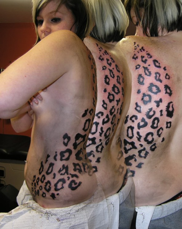 Leopard And Flame Tribal Tattoos