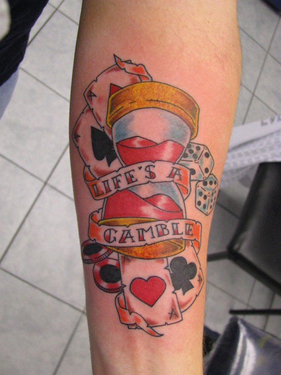 Lifes A Gamble Tattoo On Left Arm