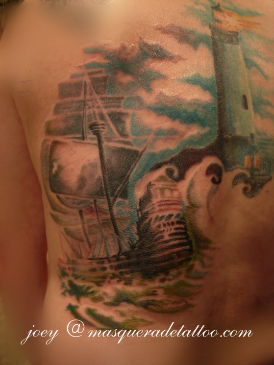 Lighthouse And Pirate Ship Tattoos On BackBody