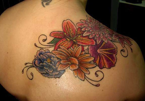 Lily Flower Tattoo On Lower Back