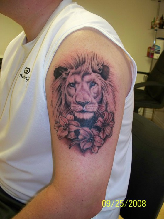 Lion And Flowers Tattoo On Biceps