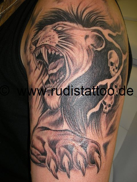 100 lion and skulls tattoo designs lion and skulls for Aztec lion tattoo meaning