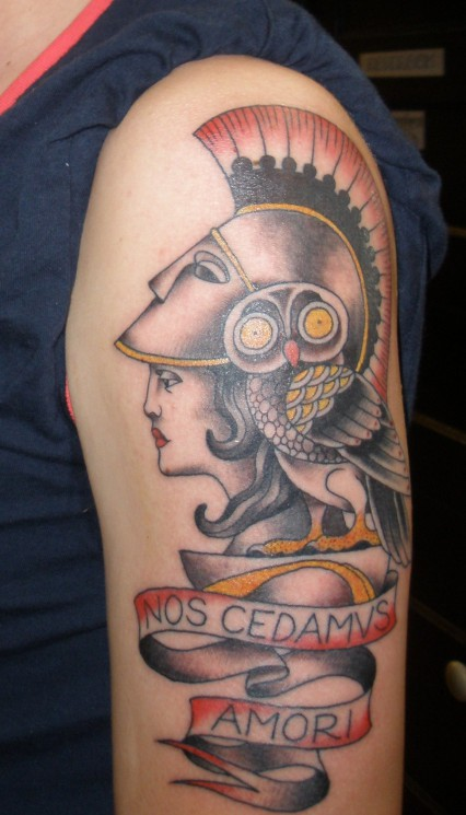 Lovely Athene And Helmet Tattoos On Biceps