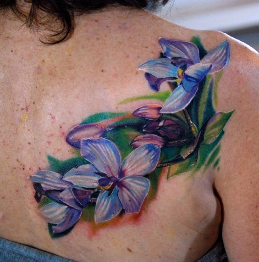 Lovely Flower Orchid Tattoo On Back Of Shoulder
