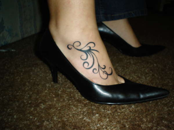 Lovely Helmet And Vine Tattoos On Ankle For Girls