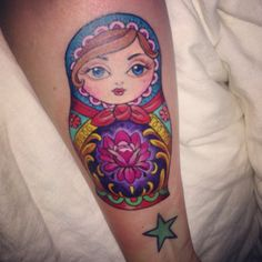 Lovely Matryoshka Tattoo With Star On Arm