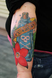Lovely Perfume Bottle And Flower Tattoos On Lower Arm