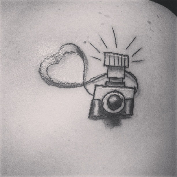 Lovely Woman With Camera Tattoo Design