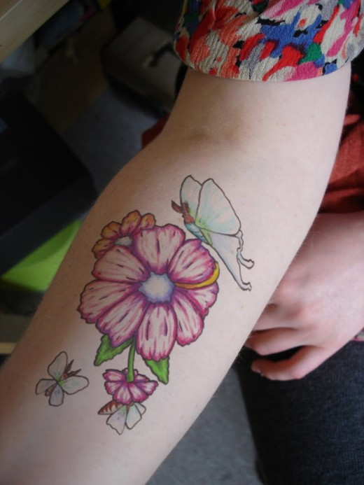 Lovely Woman With Flower Tattoo On Arm
