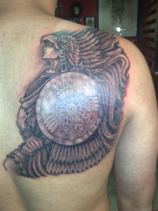Lower Back Aztec Warrior Tattoo
