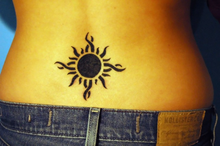 Lower Back Sun And Moon Tattoo For Girls