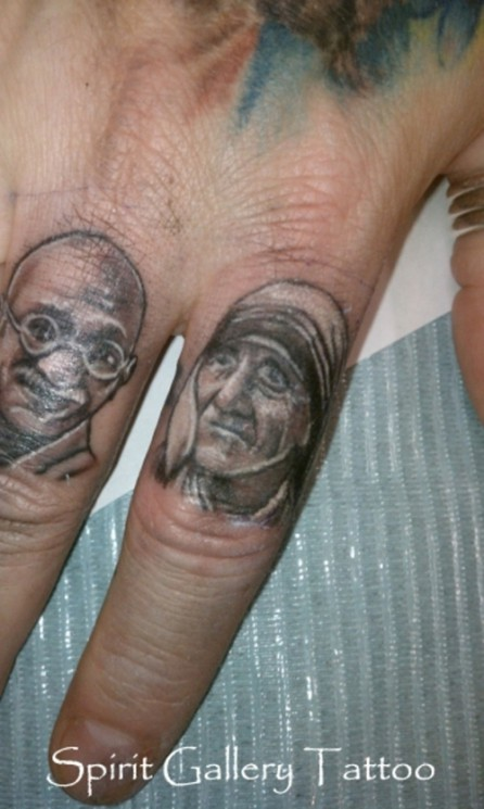 Mahatma Gandhi And Mother Teresa Portrait Tattoos On Fingers