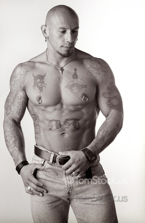 Man With Nipple Piercing And Muscles Tattoos