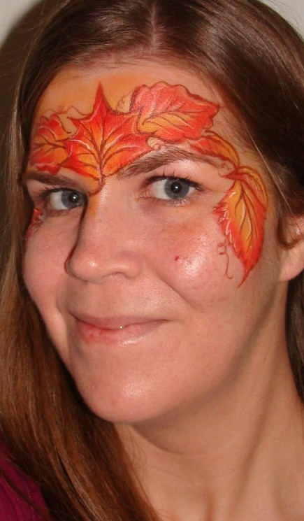 Maple Leaves Tattoo On Face Of Girl