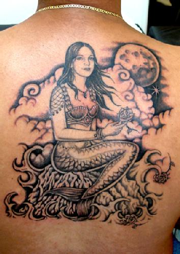 Mermaid Sitting Tattoo On Back