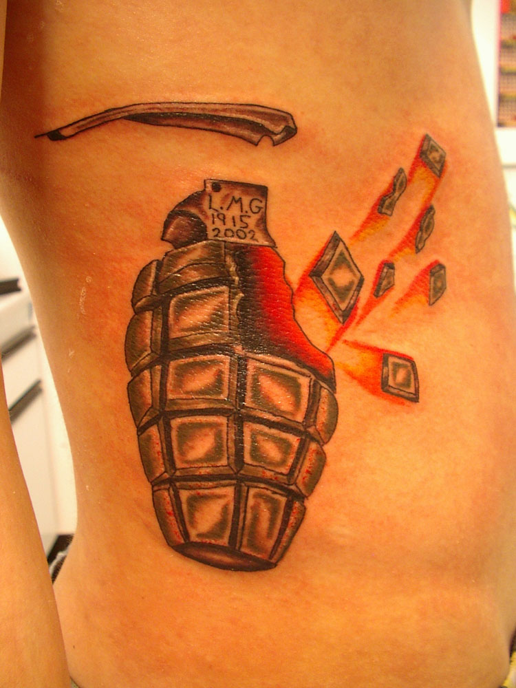 military grenade tattoo on side in 2017 real photo pictures images and sketches tattoo. Black Bedroom Furniture Sets. Home Design Ideas