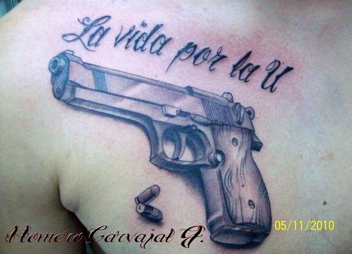 Military Gun Tattoo With Bullets On Chest