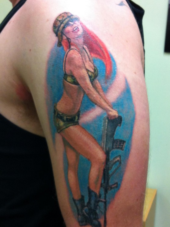 Military Pin Up Girl With Gun Tattoo On Arm