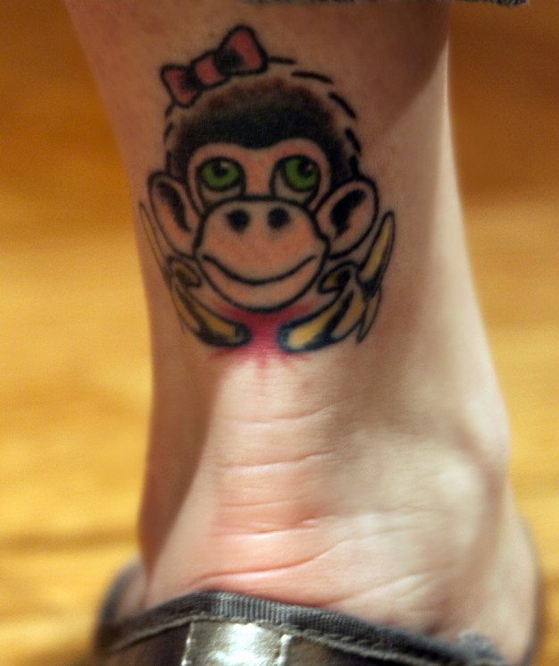 Monkey With Bananas And Bow Tattoo On Back Ankle