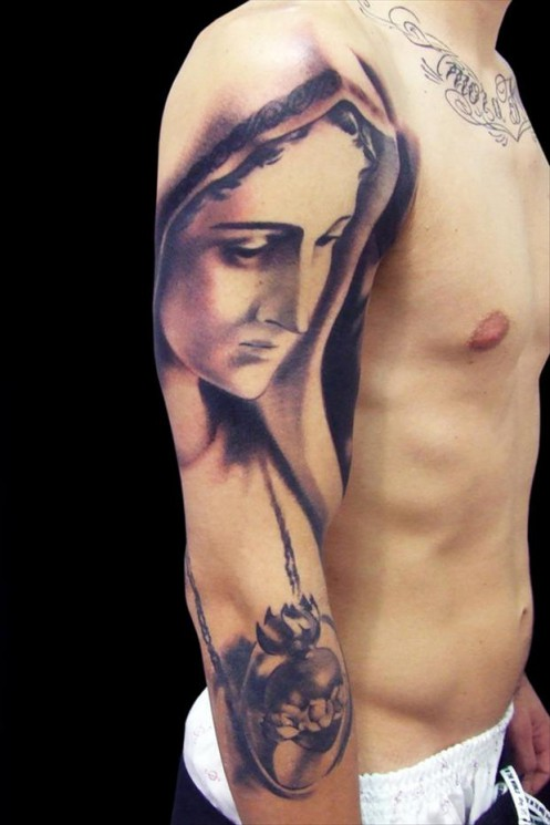 Mother Mary Tattoo On Upper Arm